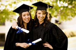 Two female college graduates majoring in science engineering mathematics